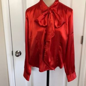 Red blouse with bow at neck